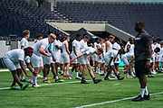 NFL Academy student athletes warm up during the NFL Media Day held at Tottenham Hotspur Stadium, London, United Kingdom on 2 July 2019.