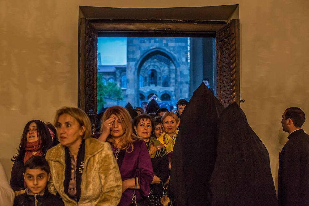 VAGHARSHAPAT, ARMENIA - APRIL 23: Armenian faithful enter Etchmiadzin Cathedral, which is the mother church of the Armenian Apostolic Church and is considered the oldest cathedral in the world, following a canonization ceremony for victims of the Armenian genocide on April 23, 2015 in Vagharshapat, Armenia. Tomorrow will mark the one hundredth anniversary of events generally considered to be the start of a campaign of genocide against minority ethnic Armenians living in present-day eastern Turkey by the Ottoman government over fears of their allegiance during World War I. (Photo by Brendan Hoffman/Getty Images) *** Local Caption ***