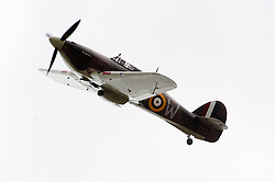 A vintage second world Hawker Hurricane fighter performs a fly past at the Northallerton Wartime Weekend 2010<br />