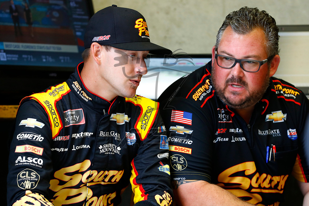 Daniel Hemric (21) hangs out in the garage area during a rain delay for practice for the Lilly Diabetes 250 at Indianapolis Motor Speedway in Indianapolis, Indiana.