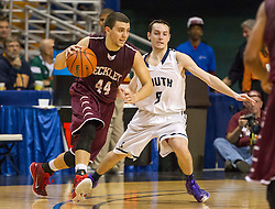 Woodrow Wilson forward Brent Osborne (44) gets past Parkersburg South guard Ty Dobson (0) during a semi-final game at the Charleston Civic Center.