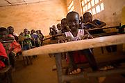 Children attend class at the Idrissa Diouf primary school in Bignona, Senegal, on Tuesday June 12, 2007.