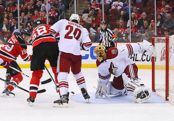 Mar 27, 2014; Newark, NJ, USA; New Jersey Devils right wing Jaromir Jagr (68) and New Jersey Devils center Travis Zajac (19) look for the puck after a save by Phoenix Coyotes goalie Thomas Greiss (1) during the first period at Prudential Center.
