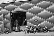 Workmen on a break outside Louis Vuitton. Bond St. London. 21 August 2019