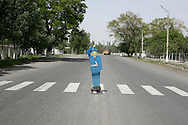 A lollypop man near a school, near Kokand