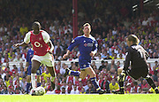 Premiership Football - Arsenal v Leicester City:.2003/04 Season - 15/05/2004  [Record breaking Season undefeated] .Patrick Vieira, run's in to score his first goal, beating and leaving Fox's keeper Ian Walker and to make the score 2-1.[Credit] Peter Spurrier Intersport Images