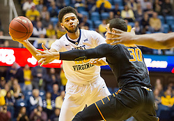 Jan 9, 2016; Morgantown, WV, USA; West Virginia Mountaineers forward Esa Ahmad (23) passes to a teammate during the first half against the Oklahoma State Cowboys at the WVU Coliseum. Mandatory Credit: Ben Queen-USA TODAY Sports