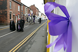 © Licensed to London News Pictures. 18/01/2015. Measham, Leicestershire, UK. The scene outside St Laurence's Church in the centre of Measham for the service of Kayleigh Haywood. Pictured, the funeral procession makes it's way along the High Street after the service. Photo credit : Dave Warren/LNP
