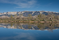Reflections of the Roan cliffs in Rifle Pond near Rifle, Colorado.
