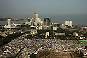 A view from top 34th floor of the fashionable hotel Four Seasons over the Worli district, one of the higher class areas in Mumbai with slum pockets nestling between the highrisers. More than 2.000 slum pockets is scattered around Mumbai.