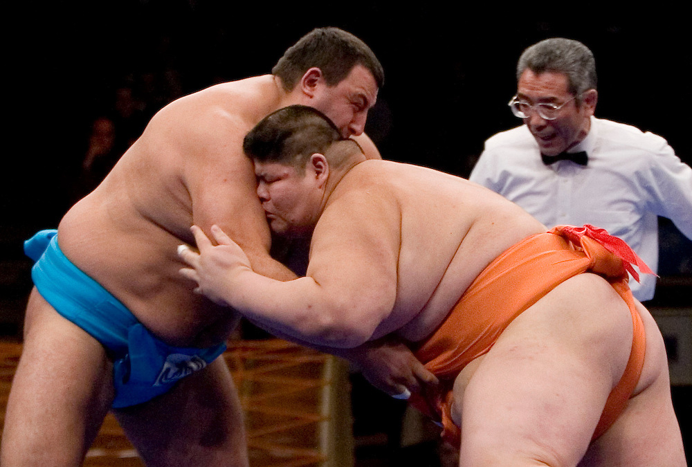 Peter Stayanov, left, of Bulgaria, and Mitshuhiko Fukao of Japan, wrestle in the Final round of the World Sumo Challenge, Saturday 22 October 2005.  at New York's Madison Square Garden. Fukao won the match.