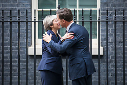 © Licensed to London News Pictures. 21/02/2018. London, UK. Prime Minister Theresa May (L) greets Dutch Prime Minister Mark Rutte (R) on Downing Street. Photo credit: Rob Pinney/LNP