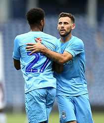 Coventry City's Jordon Thompson celebrates scoring his side's second goal of the game with Tony Andreu (right) during the Cyrille Regis Memorial Trophy match at The Hawthorns, West Bromwich.