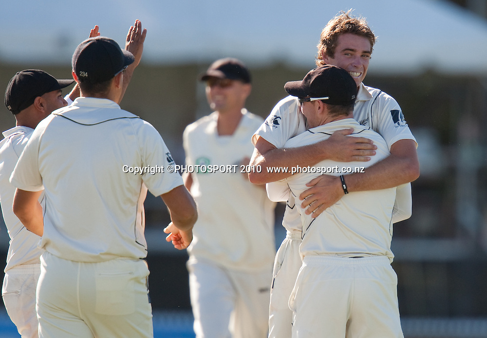 Tim Southee celebrates taking the wicket of M North by hugging Brendon McCullum during day one of the 2nd cricket test match between NZ Black Caps and Australia, at Seddon Park, Hamilton, 27 March 2010. Photo: Stephen Barker/PHOTOSPORT