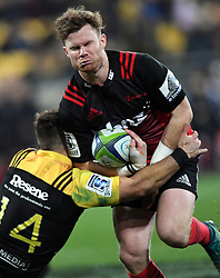 Crusaders Mitchell Drummond runs into the tackle of Hurricanes Nehe Milner-Skudder in Super Rugby match at Westpac Stadium, Wellington, New Zealand, Saturday, July 15, 2017. Credit:SNPA / Ross Setford  **NO ARCHIVING""