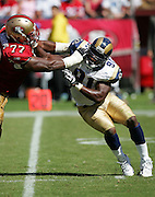 SAN FRANCISCO - SEPTEMBER 17:  Defensive end Leonard Little #91 of the St. Louis Rams has trouble getting around a block by offensive tackle Kwame Harris #77 of the San Francisco 49ers at Monster Park on September 17, 2006 in San Francisco, California. The Niners defeated the Rams 20-13. ©Paul Anthony Spinelli *** Local Caption *** Leonard Little;Kwame Harris