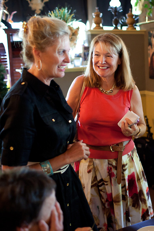 Political aide Susan Duprey (R) smiles at Ann Romney, the wife of Mitt Romney, during a campaign event at  Michele's Ristorante in Keene, NH on August 11, 2011.  (Matthew Cavanaugh for The Boston Globe)