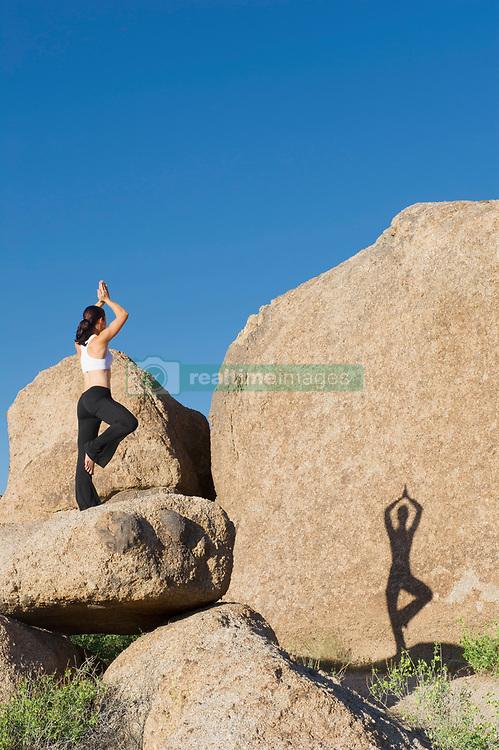 Woman in tree position on boulder (Credit Image: © Image Source/Les & Dave Jacobs/Image Source/ZUMAPRESS.com)
