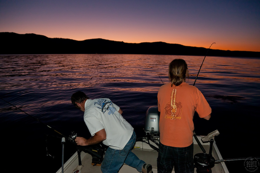 """Fishing Lake Tahoe at Sunset 2"" - These men were photographed fishing for Mackinaw on Lake Tahoe at sunset."