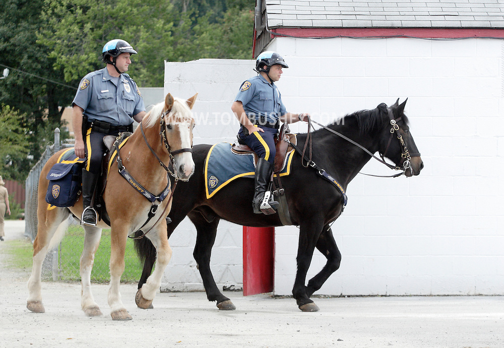 Thiells, New York -Two mounted policemen arrive at a high school football game on Sept. 26, 2009.