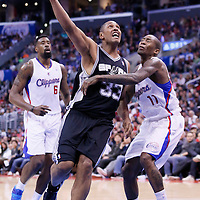 18 February 2014: San Antonio Spurs power forward Boris Diaw (33) goes for the layup past Los Angeles Clippers shooting guard Jamal Crawford (11) during the San Antonio Spurs 113-103 victory over the Los Angeles Clippers at the Staples Center, Los Angeles, California, USA.