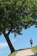 A runner climbs the steep ramparts of Kastellet in Copenhagen