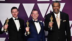 David Rabinowitz, Charlie Wachtel and Kevin Willmott pose with the Best Adapted Screenplay award for 'BlacKkKlansman' in the press room at the 91st Academy Awards held at the Dolby Theatre in Hollywood, Los Angeles, USA.