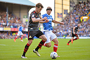 Doncaster Rovers Forward, John Marquis (9) and Portsmouth Forward, Curtis Main (14) during the EFL Sky Bet League 2 match between Portsmouth and Doncaster Rovers at Fratton Park, Portsmouth, England on 1 October 2016. Photo by Adam Rivers.