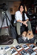 Malaysian documentary photographer and videographer, Suzanne Lee poses for a portrait in her home-office in New Delhi, India. Photo by Sanjit Das
