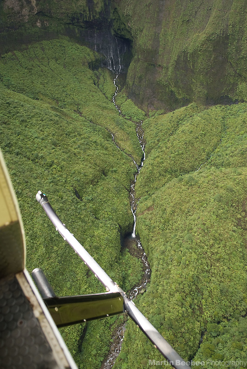 The headwaters of the North Fork Wailua River, as seen through the open door of a helicopter, begin at the base of Wai'ale'ale Crater, Kauai, Hawaii.