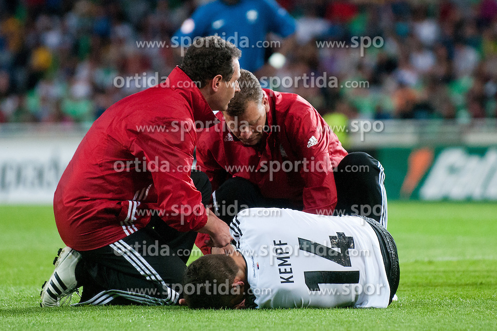 Doctors helping Marc Oliver Kempf of Germany that is lying on the ground after crash with Corentin Jean of France during the UEFA European Under-17 Championship Group A match between Germany and France on May 10, 2012 in SRC Stozice, Ljubljana, Slovenia. Germany defeated France 3:0. (Photo by Matic Klansek Velej / Sportida.com)