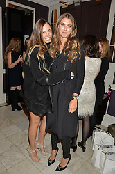 Left to right, AMBER LE BON and SABRINA PERCY at the Tatler Little Black Book Party held at Home House Private Member's Club, Portman Square, London supported by CARAT on 6th November 2014.