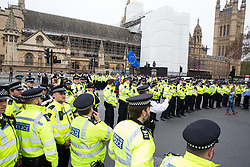 London, UK. 23rd April 2019. A Metropolitan Police cordon in Parliament Square positioned so as to prevent climate change activists from Extinction Rebellion from attempting to deliver letters to Members of Parliament requesting meetings to discuss the issue of climate change.