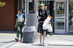 Shiloh and Knox Jolie-Pitt coming out of Petco.