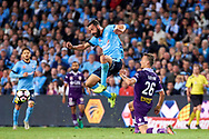 April 29, 2017: Sydney FC forward Alex BROSQUE (captain) (14) jumps over Perth Glory Lucian GOIAN (26) at Semi Final one of the 2016/17 Hyundai A-League match, between Sydney FC and Perth Glory, played at Allianz Stadium in Sydney.