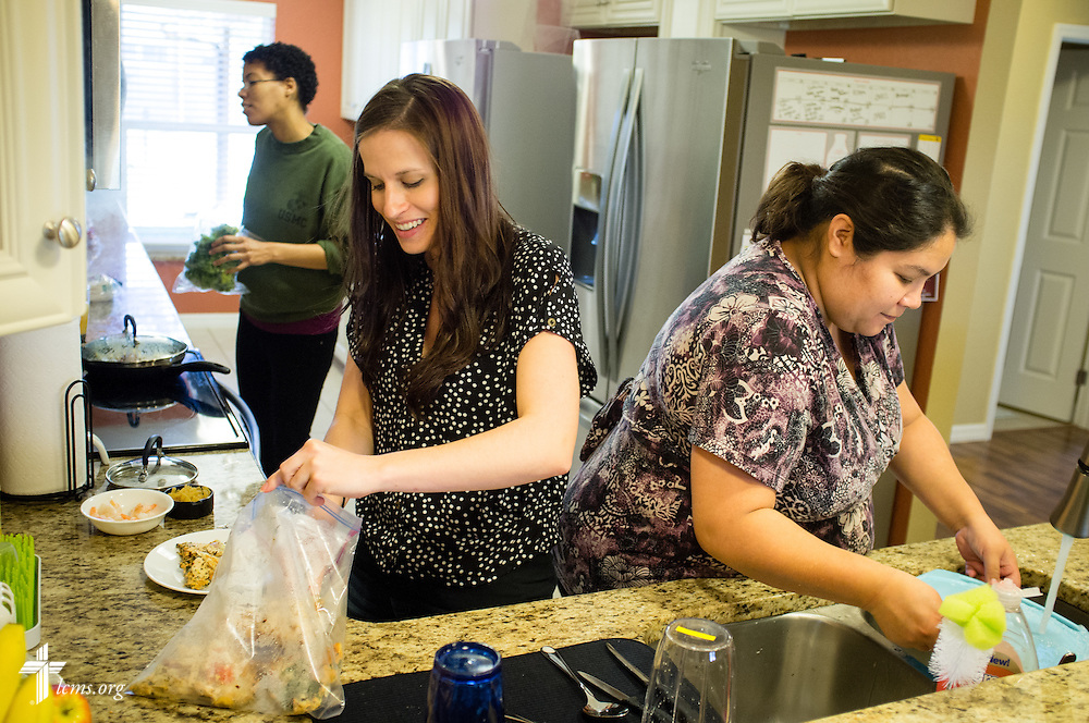 Resident Director Rachel Woolery (center) joins Jenny (left) and Lillian as they make lunch at Redeeming Life Maternity Home  on Thursday, Feb. 12, 2015, in Sanford, Fla. The Christ-centered home of Redeeming Life Outreach Ministries is a safe haven for single women in crisis pregnancy. LCMS Communications/Erik M. Lunsford