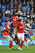 Charlton Athletic defend a corner and Charlton Athletic goalkeeper Nick Pope punches the ball away during the Sky Bet Championship match between Reading and Charlton Athletic at the Madejski Stadium, Reading, England on 17 October 2015. Photo by Mark Davies.