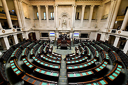 March 17, 2020, Brussels, Belgium: Belgian Prime Minister SOPHIE WILMES (C) addresses a near-empty Parliament, with only the Vice-Prime Ministers and the Group Leaders present, during a plenary session of the chamber at the federal parliament. It is expected that the Prime Minister will ask a vote of confidence for her minority government in current affairs, so that the government can take the necessary decisions to fight the corona crisis more easily. (Credit Image: © Dirk Waem/Belga via ZUMA Press)