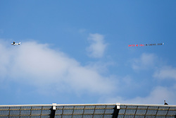 "A plane flies over with the slogan ""United We Fall - In Cinemas Now"" presumably mocking local rivals Manchester United - Photo mandatory by-line: Rogan Thomson/JMP - 07966 386802 - 21/08/2014 - SPORT - FOOTBALL - Manchester, England - Etihad Stadium - Manchester City v Chelsea FC - Barclays Premier League."