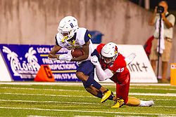 NORMAL, IL - September 21: Dylan Draka stops the advance of Stacy Chukwumezie during a college football game between the ISU (Illinois State University) Redbirds and the Northern Arizona University (NAU) Lumberjacks on September 21 2019 at Hancock Stadium in Normal, IL. (Photo by Alan Look)