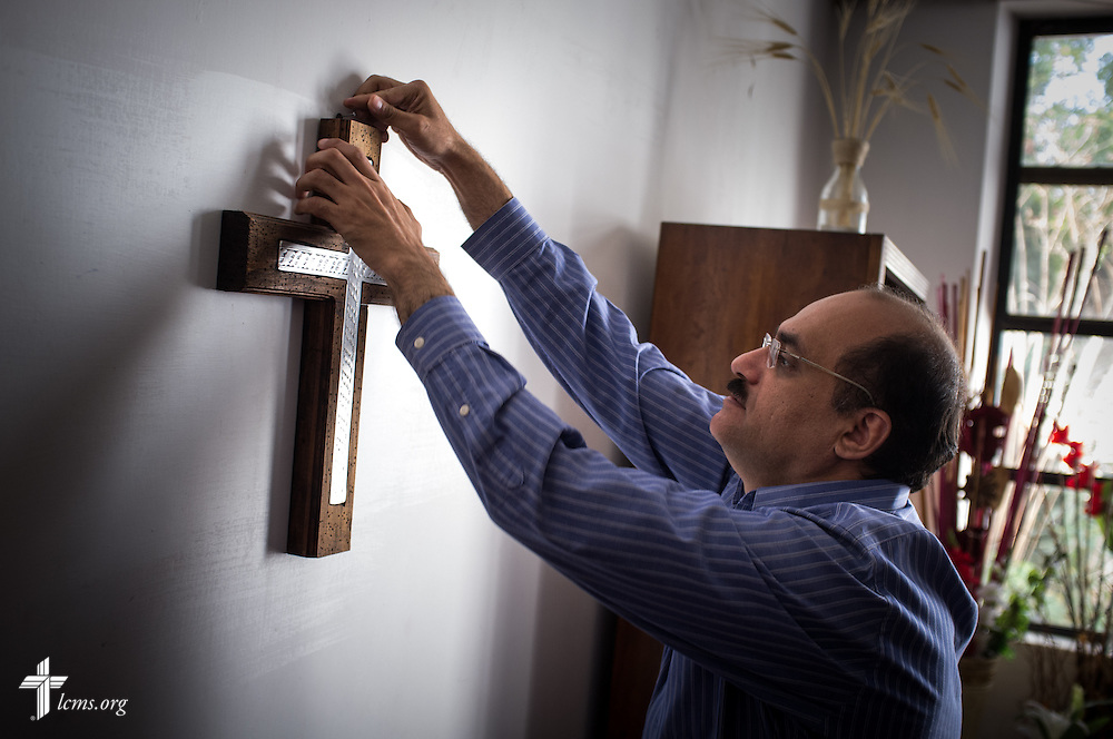 Parishioner David Linares rehangs the cross in the sacristy following a church council meeting at Lutheran Church of The Good Shepherd on Saturday, Jan. 14, 2017, in Mexico City. It was taken down temporarily for a projected presentation. LCMS Communications/Erik M. Lunsford