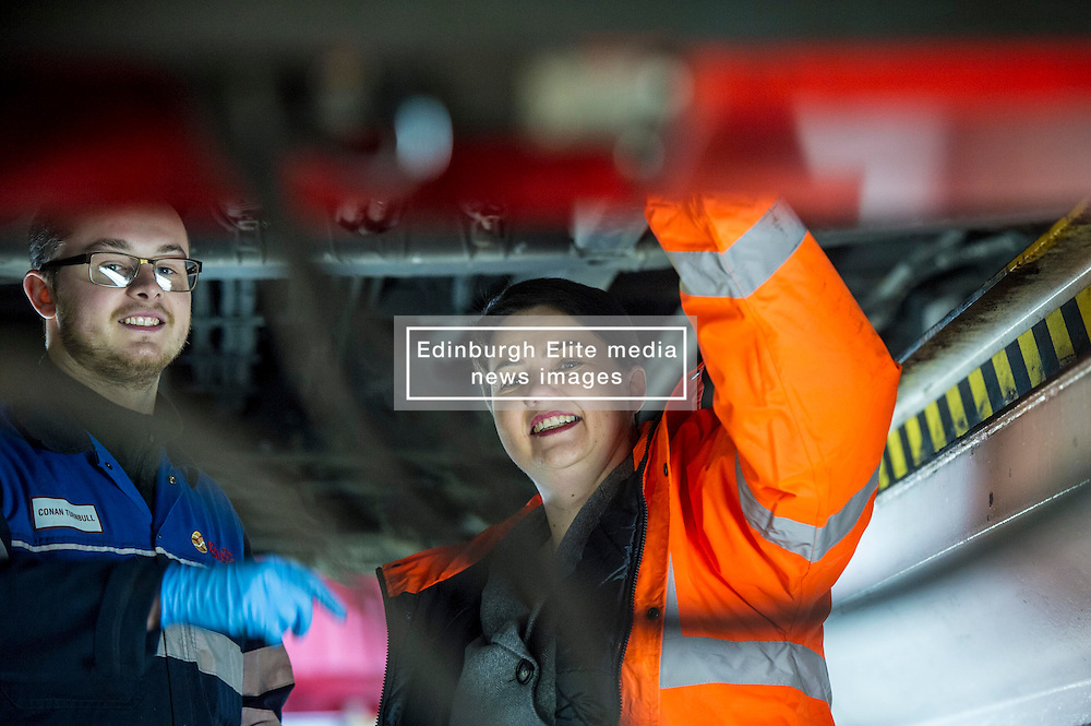 Pictured: Apprentice Conan Turnbull showed Ruth Davidson the dirty side of the job<br /> Scottish Conservative leader Ruth Davidson, MSP,  visited Lothian Buses today in Edinburgh to meet apprentices at the start of Apprenticeship Week. While there she was shown round by Managing Director Richard Hall and attempted to change a wheel.<br /> <br /> Ger Harley | EEm 7 March 2017