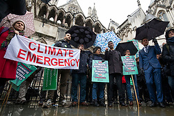 © Licensed to London News Pictures. 27/02/2020. London, UK. Protesters who oppose the expansion of Heathrow Airport outside the High Court. Judges will deliver their ruling on a number of appeals against the planned construction of a third runway at the London airport. Photo credit: Rob Pinney/LNP
