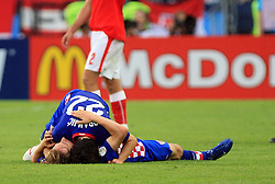 Danijel Pranjic holding Luka Modric (lying on the floor) of Croatia after the final whistle at the UEFA EURO 2008 Group B soccer match between Austria and Croatia at Ernst-Happel Stadium, on June 8,2008, in Vienna, Austria.  (Photo by Vid Ponikvar / Sportal Images)