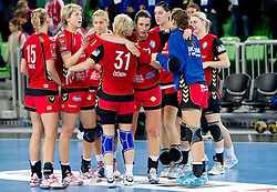 Andrea Penezic and other players of Krim celebrate during handball match between RK Krim Mercator (SLO) and RK Podravka Vegeta (CRO) in Women's EHF Champions League, on November 13, 2010 in Arena Stozice, Ljubljana, Slovenia. Krim defeated Podravka 26:22 and qualified to Main Round of Champions League. (Photo By Vid Ponikvar / Sportida.com)