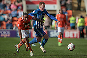 Michael Woods (Hartlepool United) runs past Neil Danns (Blackpool) during the EFL Sky Bet League 2 match between Blackpool and Hartlepool United at Bloomfield Road, Blackpool, England on 25 March 2017. Photo by Mark P Doherty.