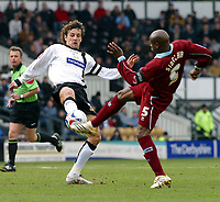 Photo: Dave Linney.<br />Derby County v Burnley. Coca Cola Championship. 11/03/2006.Derby's (L) in high kicking action with  Frank Sinclair