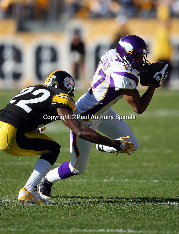 Minnesota Vikings wide receiver Greg Lewis (17) catches a pass and gets tackled by Pittsburgh Steelers cornerback William Gay (22) during the NFL football game, October 25, 2009 in Pittsburgh, Pennsylvania. The Steelers won the game 27-17. (©Paul Anthony Spinelli)