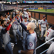 NEW YORK, NEW YORK - July 07: Clint Robinson #25 of the Washington Nationals is congratulated by Bryce Harper #34 of the Washington Nationals as he returns to the dugout after hitting a home run during the Washington Nationals Vs New York Mets regular season MLB game at Citi Field on July 07, 2016 in New York City. (Photo by Tim Clayton/Corbis via Getty Images)