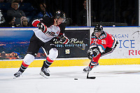 KELOWNA, CANADA - DECEMBER 8:  Henrik Nyberg #21 of the Kelowna Rockets lunges for the puck against the Prince George Cougars at the Kelowna Rockets on December 8, 2012 at Prospera Place in Kelowna, British Columbia, Canada (Photo by Marissa Baecker/Shoot the Breeze) *** Local Caption ***